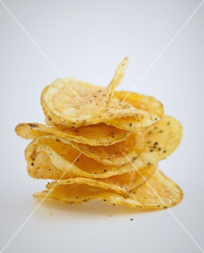 A stack of crisps on a white surface