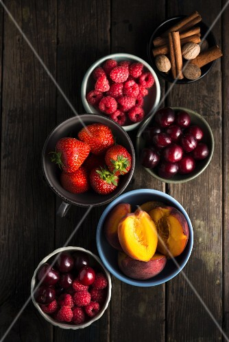 An arrangement of berries, stone fruits and spices