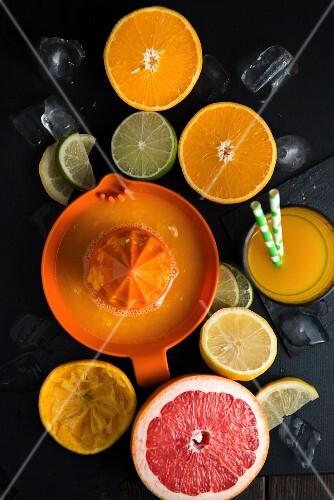 Freshly pressed orange juice and halved citrus fruit