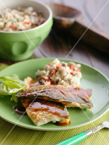 Fried seabass fillets with barbecue sauce and a rice salad
