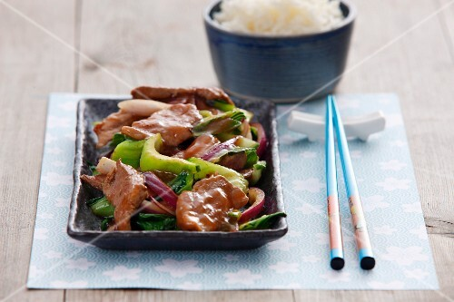 Pork with plum and wasabi sauce and vegetables