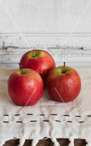 Three Pink Lady apples