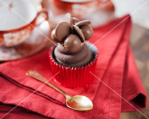 A cupcake decorated with chocolate sweets