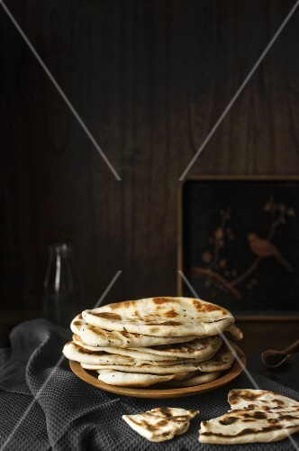 Naan bread on a wooden plate