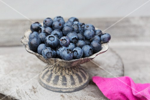 Fresh blueberries in a metal dish
