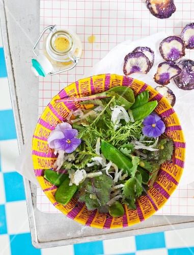 A wild salad with purple potato crisps