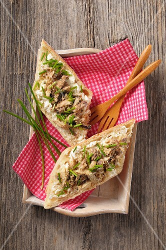 Baguette topped with mackerel rillette, chives and pepper