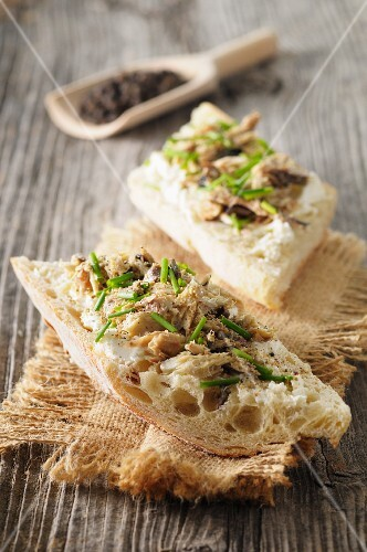 Slices of bread topped with mackerel rillettes, chives and three types of pepper