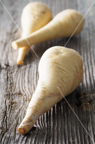 Parsnips on a wooden surface
