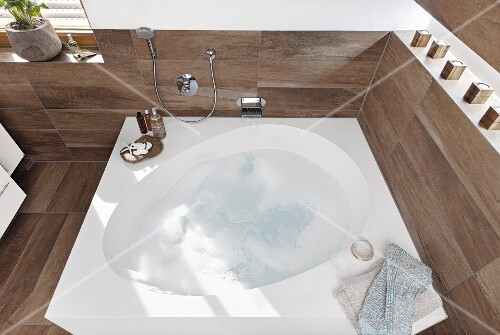 Bubbles In A Droplet Shaped Bath Set White Mineral Cast Block With