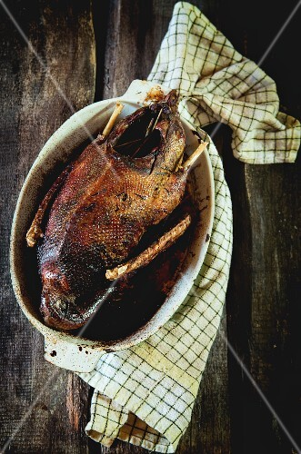 Grilled goose in a roasting dish