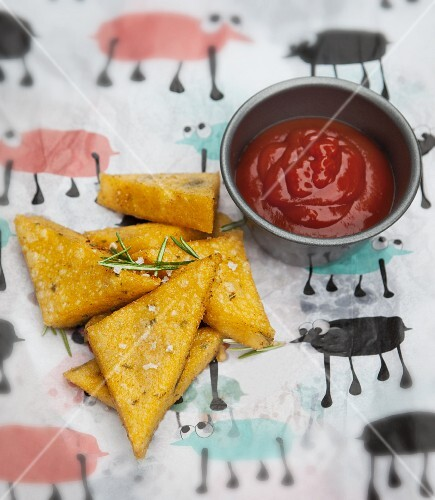 Polenta triangles with a tomato dip