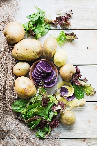 An arrangement of potatoes and lettuce leaves