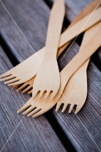 Wooden forks on a wooden table