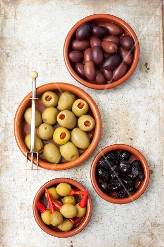 Various olives: dried, Kalamata, stuffed with pepper and stuffed with piri piri