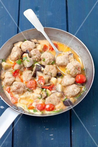 Beef meatballs with tomatoes and aubergine in a creamy sauce