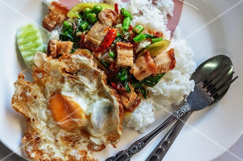 Pork belly with vegetables, Indian basil and fried egg (Thailand)
