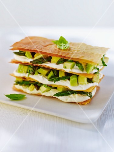 Mille feuilles with cream cheese, avocado and green asparagus