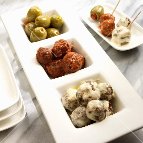 Green olives, meat balls in a creamy sauce and in a tomato sauce