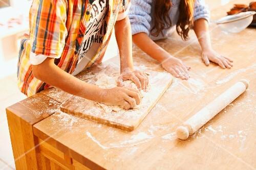 Children baking, mixing ingredients