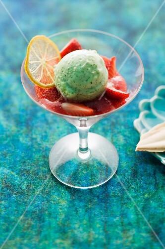 Lemon and basil ice cream on strawberries