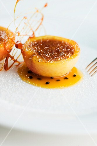 Peach with caramel and passion fruit sauce