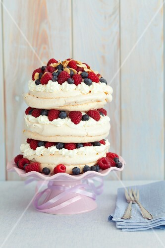 Meringue cake with cream and berries
