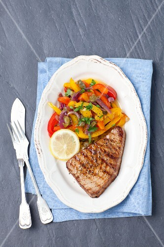 Tuna steak with roasted peppers and capers