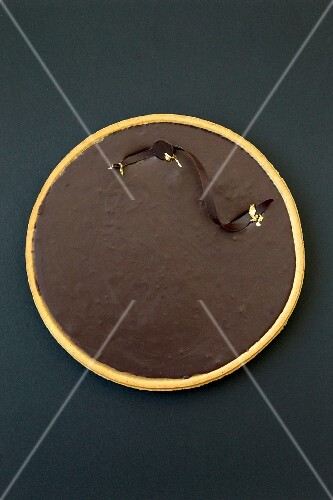 Chocolate tart with gold leaf
