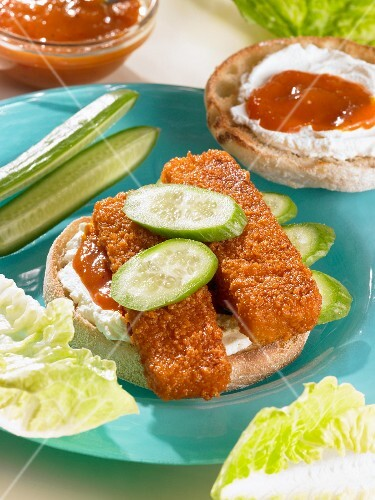 A fish finger sandwich with cream cheese and cucumber