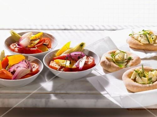 Mini focaccia with mozzarella and a summer vegetable salad