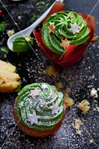 Christmas cupcakes decorated with green frosting