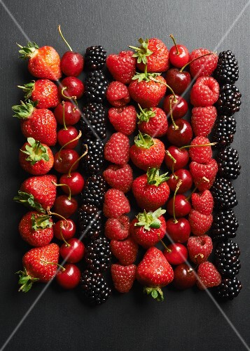 Summer fruits on a black surface