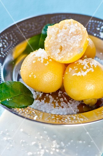 North African salted lemons in a metal bowl
