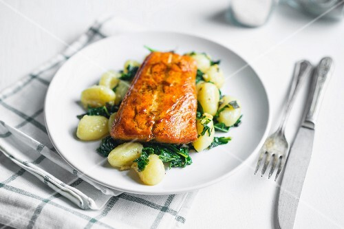 Grilled salmon with gnocchi and greens