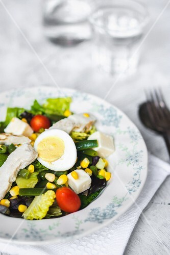 Vegetable salad with feta cheese, egg and sweetcorn