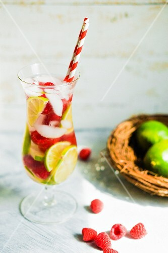 Fruity iced tea in a long drink glass with a straw