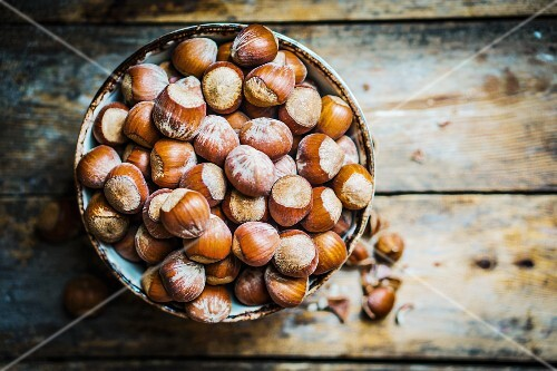 Hazelnuts in a ceramic bowl (seen from above)