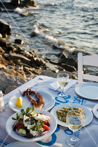 Various Greek appetisers served with salad at the Sea Satin Market Restaurant, Mykonos, Greece