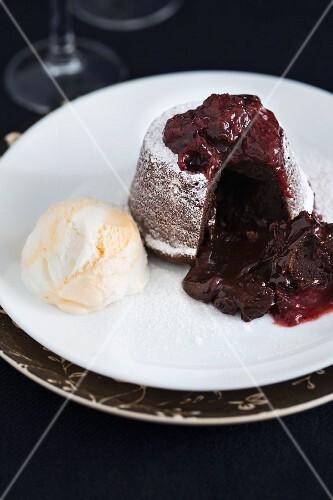 Chocolate fondant cake with raspberry sauce and vanilla ice cream