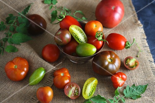 Various heirloom tomatoes, whole and halved