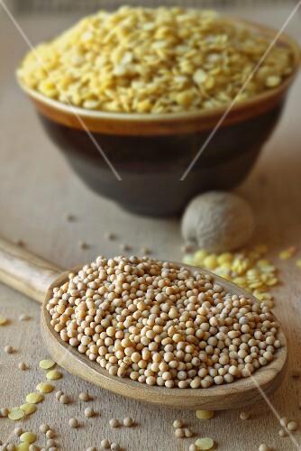 Mustard seeds on wooden spoon