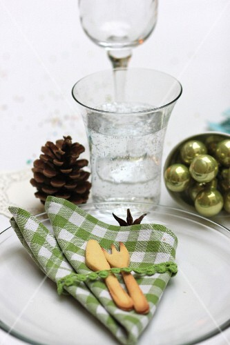 Christmas place setting with linen napkin and pastry cutlery