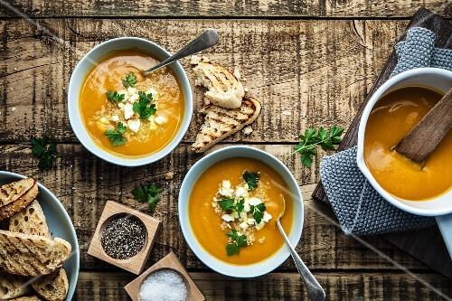 Rustic pumpkin soup with quinoa and feta