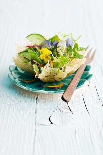 A mixed leaf salad in a Parmesan bowl