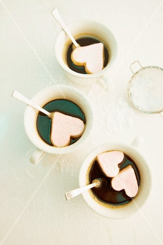 Cups of coffee with marshmallow hearts