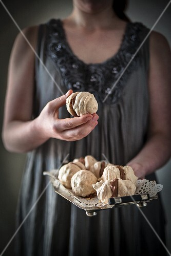 A girl holding chocolate and hazelnut meringue kisses
