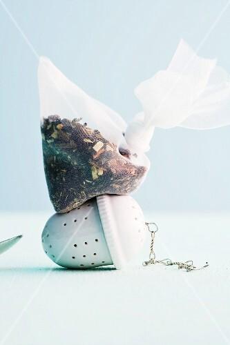 Chai tea mixture in a tea bag on a tea infuser