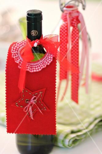 Hand-crafted, festive, felt bottle collar on wine bottle as drip catcher