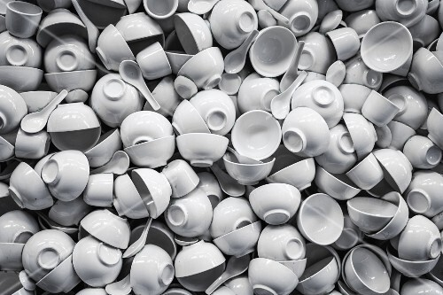 White porcelain cups, soup bowls and spoons